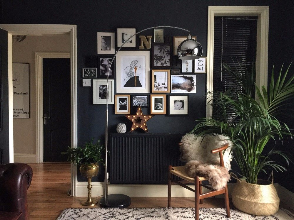 Gallery wall with navy blue paint, various sized photo frames