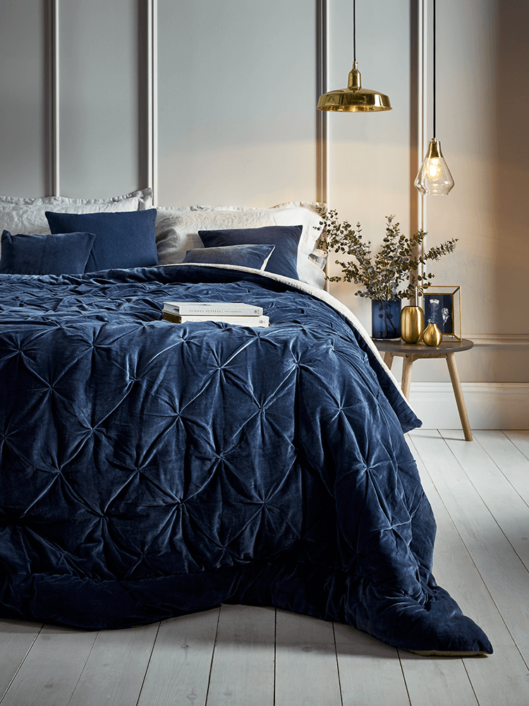 Pintuck navy velvet throw from Cox and Cox